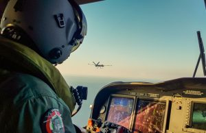 The Falco Xplorer MALE RPAS during its maiden flight, escorted by an Italian Air Force HH-139A helicopter