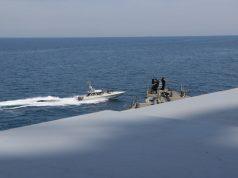 Iranian boats US Navy ships in Persian Gulf