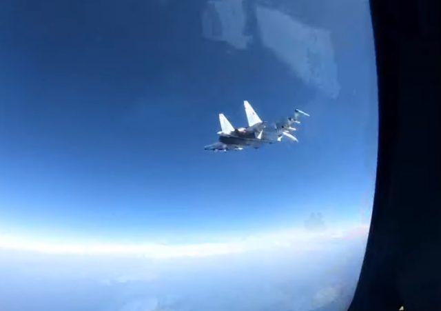 Russian SU-35 approaches US Navy Poseidon P-8A