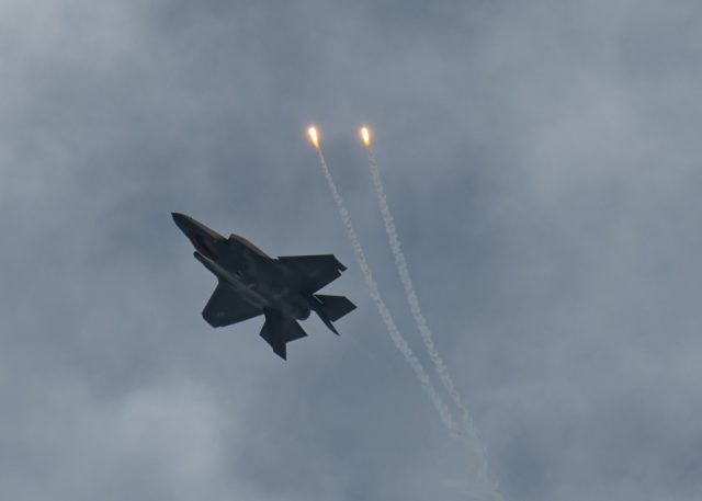 An F-35A Lightning II releases a flare while inverted over Hill Air Force Base during a demonstration practice Feb. 10, 2020, at Hill AFB, Utah