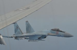 Su-35 on the wing of US Poseidon P-8A