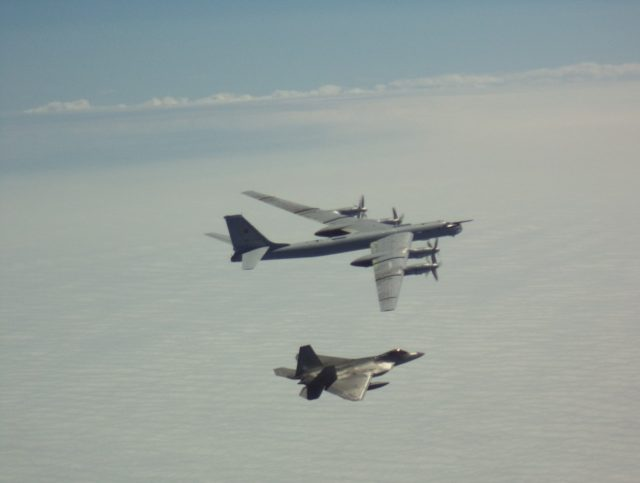 US F-22 Raptor with Russian Tu-95 bomber