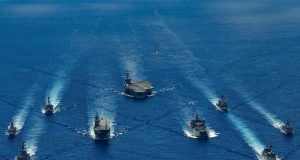 HMA Ships Canberra, Hobart, Stuart, Arunta and Sirius taking part in a trilateral passage in the Philippine Sea with US Navy ships, USS Ronald Reagan, Antietam and Mustin and the Japanese Maritime Self-Defense Force's Akizuki-class destroyer JS Teruzuki.