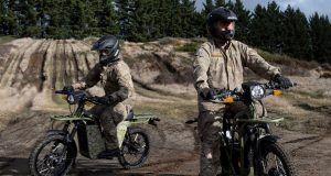 New Zealand soldiers on UBCO electric mopeds