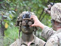 A 10th Mtn Soldier adjusts his Enhanced Night Vision Goggle - Binocular in preparation for a land navigation exercise