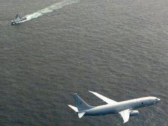 UK Poseidon flying over Russian corvette