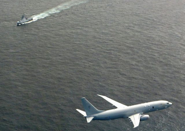 UK Poseidon flying over Russian corvette