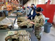 Dr. Daniel Mountjoy (left), Christine Villa, and Maj. Saily Rodriguez, with the Air Force Life Cycle Management Center's Human Systems Division, perform an inspection on new body armor units designed specifically for female Airmen in Security Forces