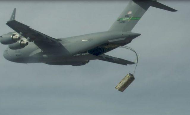 C-17 deploying palletized mock JASSM missiles
