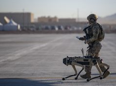 Airman with a Ghost Robotics Vision 60 robot dog