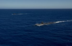 The Los Angeles-class fast-attack submarine USS Asheville (SSN 758), right, and the French Navy Rubis-class nuclear powered submarine (SSN) Émeraude steam in formation off the coast of Guam during a photo exercise. Asheville and Émeraude practiced high-end maritime skills in a multitude of disciplines designed to enhance interoperability between maritime forces. Asheville is one of four forward-deployed submarines assigned to Commander, Submarine Squadron 15