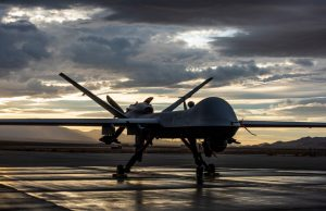 MQ-9 Reaper sits on the flight line as the sun sets at Creech Air Force Base, Nev., Nov. 20, 2019.