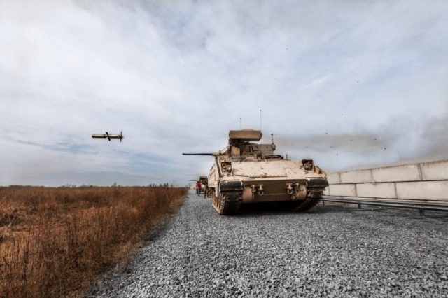 Bradley vehicle firing a TOW missile