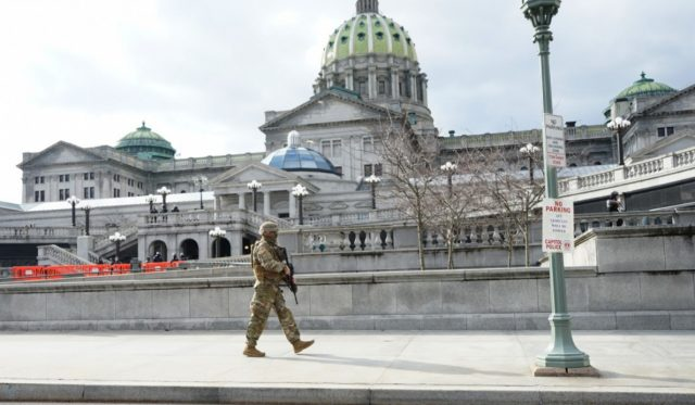 A soldier walks along his patrol at the capitol complex in Harrisburg, Pa., on Jan. 17, 2021.