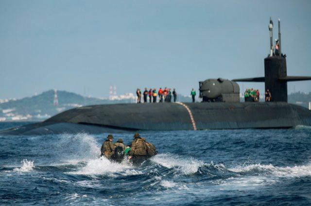 US Marines embarking Ohio-class submarine via raiding craft