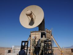 Leaders from the Army Rapid Capabilities and Critical Technologies Office enter the portable control center of Air Force Research Laboratory's Tactical High Power Operational Responder, or THOR, to view the system's drone-killing capabilities, Feb. 11, 2021 at Kirtland Air Force Base.