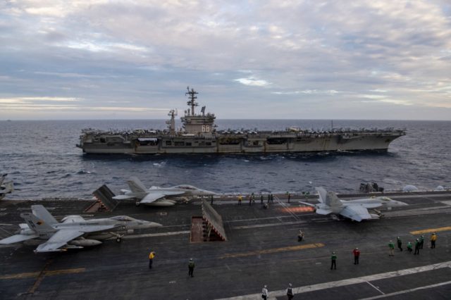"F/A-18E Super Hornet, assigned to the ""Golden Warriors"" of Strike Fighter Squadron (VFA) 87, launches from the flight deck of the aircraft carrier USS Theodore Roosevelt (CVN 71)"