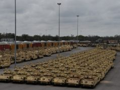 Containers and vehicles await transportation on commercial ships to Europe in support of DEFENDER-Europe 20 February 18, 2020 at the Port of Beaumont, Texas