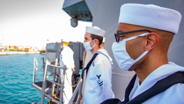 Sailors man the rails as the guided-missile destroyer USS Winston S. Churchill (DDG 81) arrived in Port Sudan, Sudan for a scheduled port visit