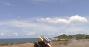 US Army firing a Naval Strike Missile from a Palletized Load System truck