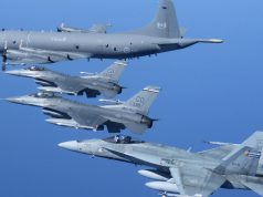 NORAD assets from the US Air Force and Royal Canadian Air Force fly in formation