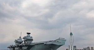 HMS Queen Elizabeth departing Portsmouth on May 1, 2021