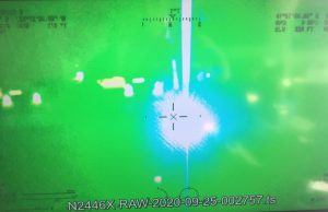 Laser pointed at an aircraft cockpit from the ground
