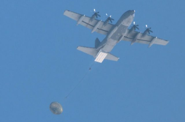 AFSOC MC-130J dropping palletized munitions