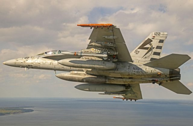 F/A-18 flies with an AARGM-ER missile