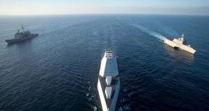 Zumwalt underway with Ticonderoga-class cruiser and LCS