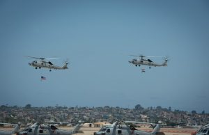 US, Indian MH-60 helicopters flying together during hand-over ceremony on July 16, 2021