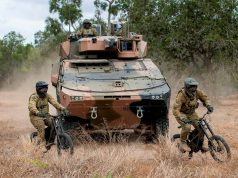 Australian Army soldiers riding a B-52 stealth e-bike