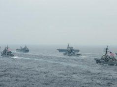 U.S. Navy Nimitz-class aircraft carrier USS Carl Vinson (CVN 70), U.S. Navy Ticonderoga-class guided-missile cruiser USS Lake Champlain (CG 57), Royal Australian Navy fleet replenishment vessel HMAS Sirius (0 266), Japan Maritime Self-Defense Force (JMSDF) Izumo-class helicopter destroyer JS Kaga (DDB 184), Royal Indian Navy Rajput-dass destroyer INS Ranvijay (D55), U.S. Navy Arleigh Burke-class guided-missile destroyer USS Stockdale (DDG 106) and JMSDF Murasame-class destroyer JS Murasame (DD 101) transit the Bay of Bengal as part of MALABAR 2021, Oct. 12, 2021.